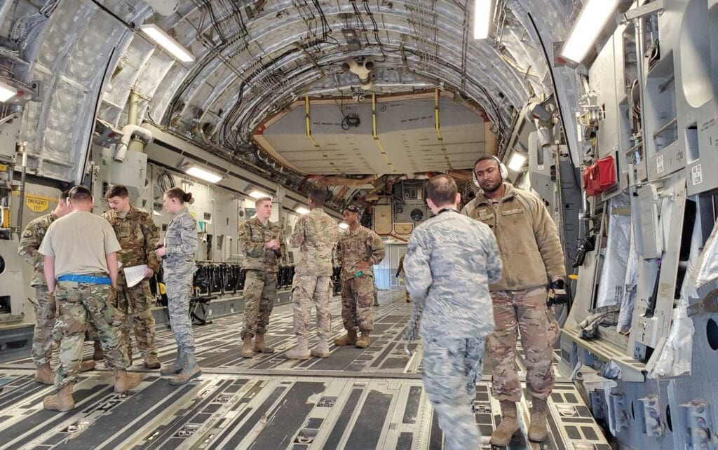 Airmen at Pope Army Airfield, Fort Bragg, NC, prepare to load a C-17 bound for the U.S. Central Command area of operations on January 4, 2020.
