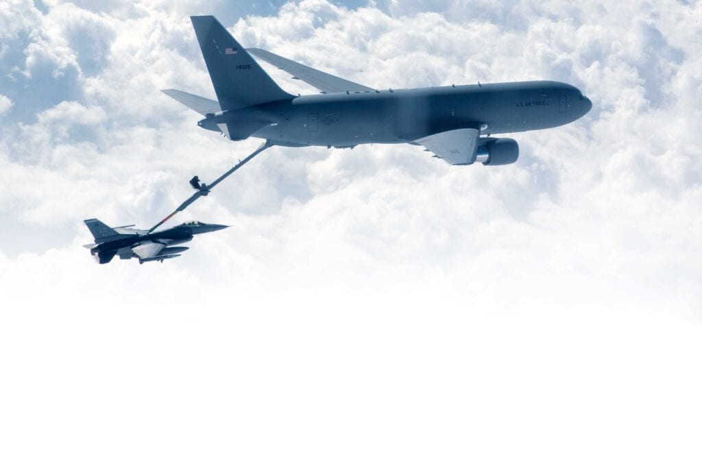 F-16 receives fuel from a KC-46 Pegasus.
