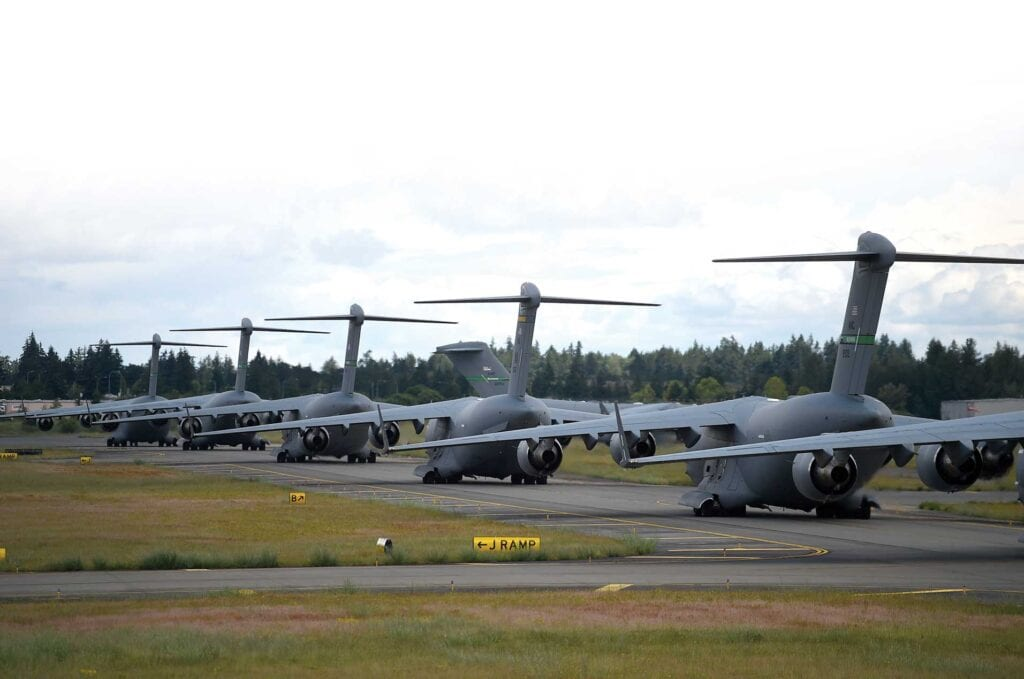 C-17 Globemaster IIIs prepare to take off.