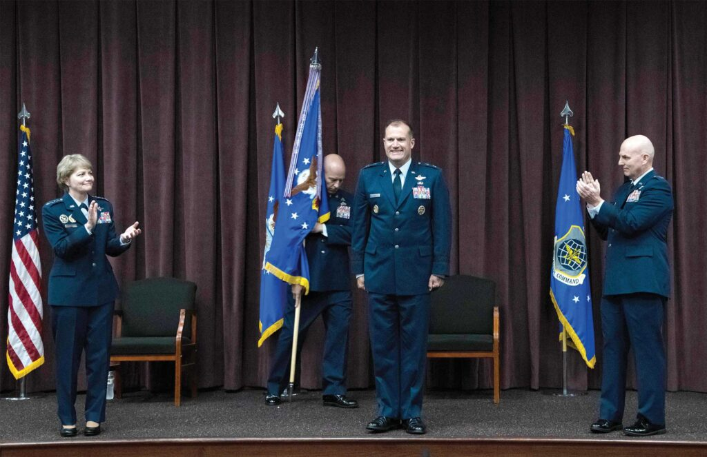 Gen Maryanne Miller, former Commander of Air Mobility Command, applauds as Maj Gen Kenneth T. Bibb, Jr., assumes command of 18th Air Force from Maj Gen Sam C. Barrett during a change of command ceremony, Aug. 18, 2020, at Scott Air Force Base, IL. USAF photo