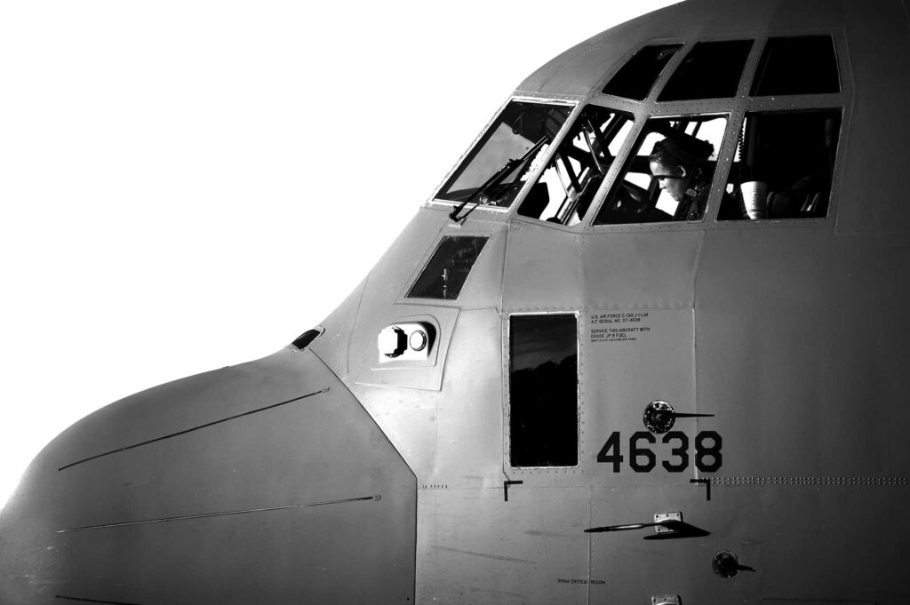 A C-130 Hercules pilot assigned to Air Mobility Command prepares the cockpit of her aircraft before taking off to conduct high-altitude air drop missions and static line troop drops from Little Rock Air Force Base, AR. USAF photo by SSgt Kenny Holston