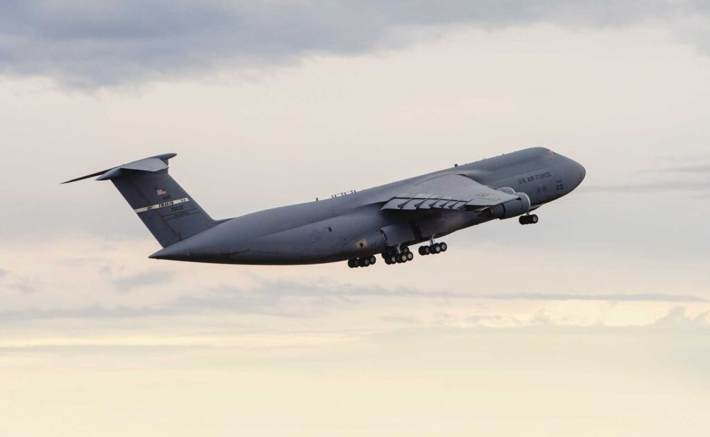 A C-5M Super Galaxy loaded with cargo and personnel headed to Naval Station Rota, Spain, takes off Jan. 16, 2019 from Travis Air Force Base, CA, in support of a multimodal stage mission.
