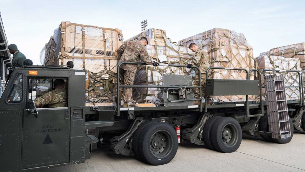 Members of the 436th Aerial Port Squadron, Dover AFB, DE, and Army's 622d Movement Control Team, Joint Base Langley-Eustis, VA, engage cargo pallet locks on a 60-ton K-loader Jan. 10, 2020, on Dover Air Force Base, DE. In a scheduled joint partnership training event, 16 members from the 622d MCT came to Dover AFB for cargo and personnel processing training. USAF photo by Roland Balik