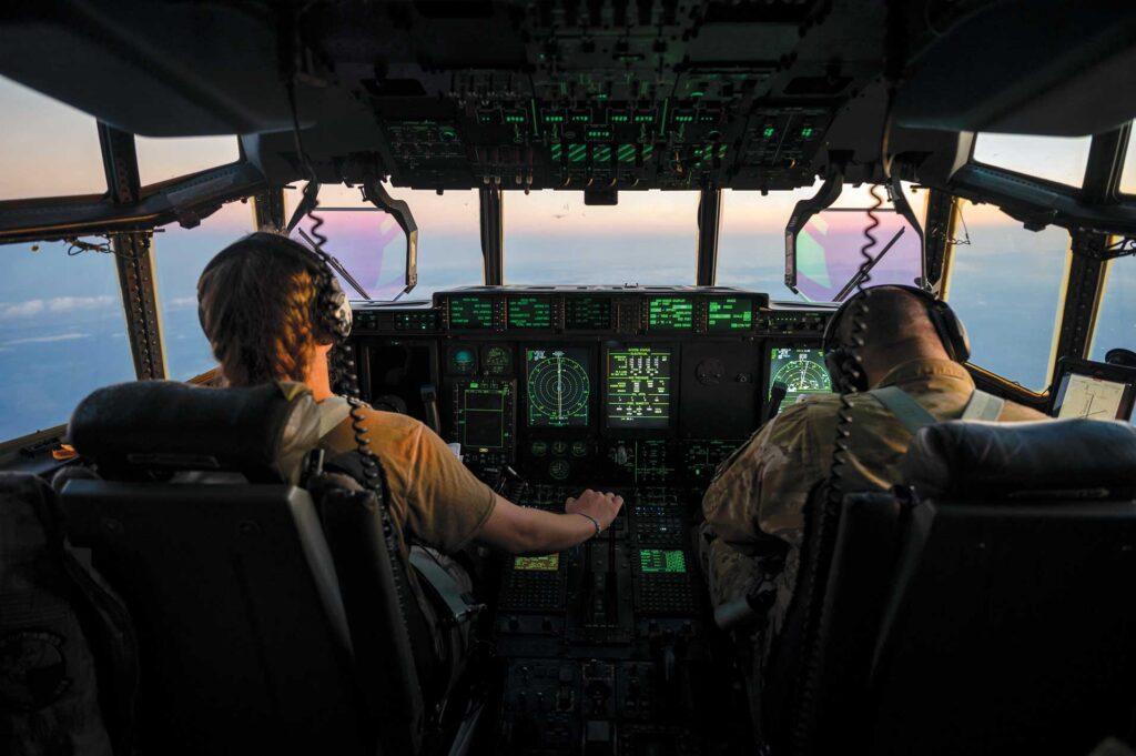1 Lt Riley Richards and Capt Christopher Cruz operate a C-130J Super Hercules