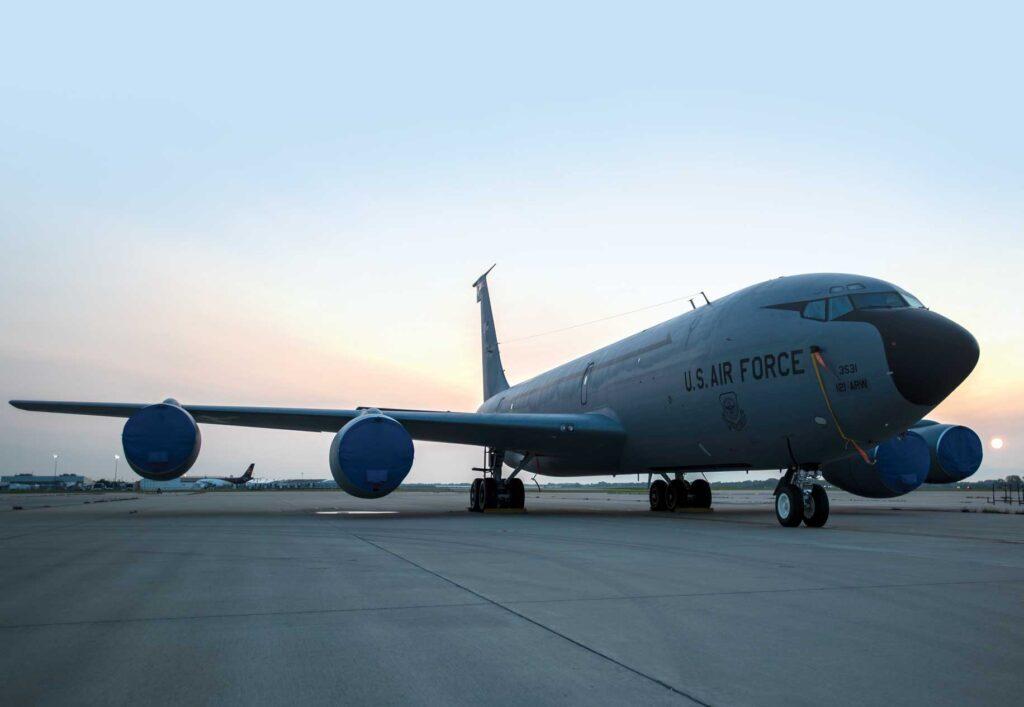 A KC-135 Stratotanker sits on the flightline during sunrise